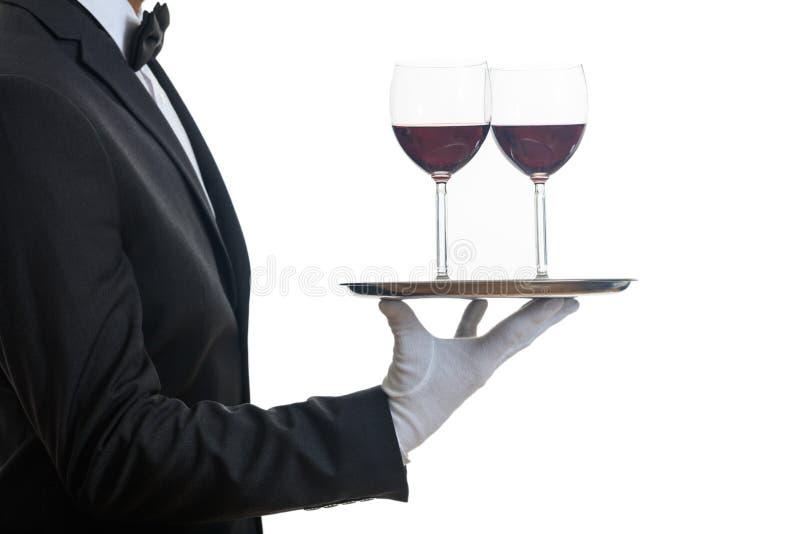 Kelner porci wino na tacy zdjęcia royalty free
