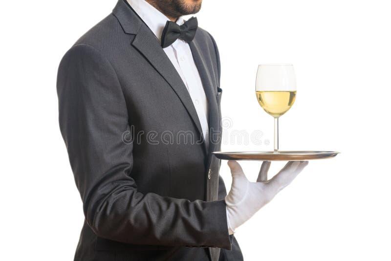 Kelner porci wino na tacy zdjęcie royalty free