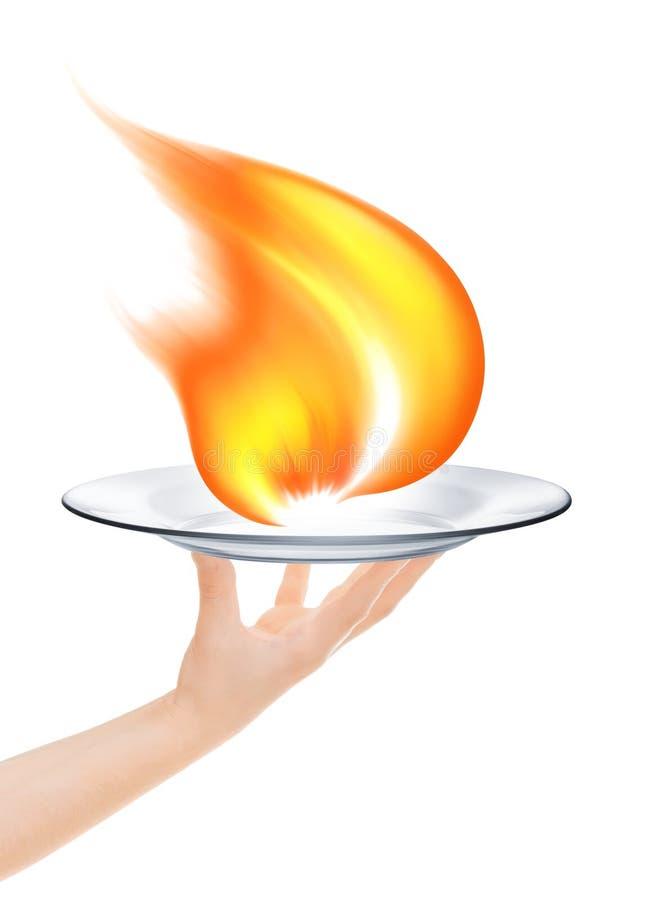Kelner trzyma talerza z ogieniem obraz royalty free