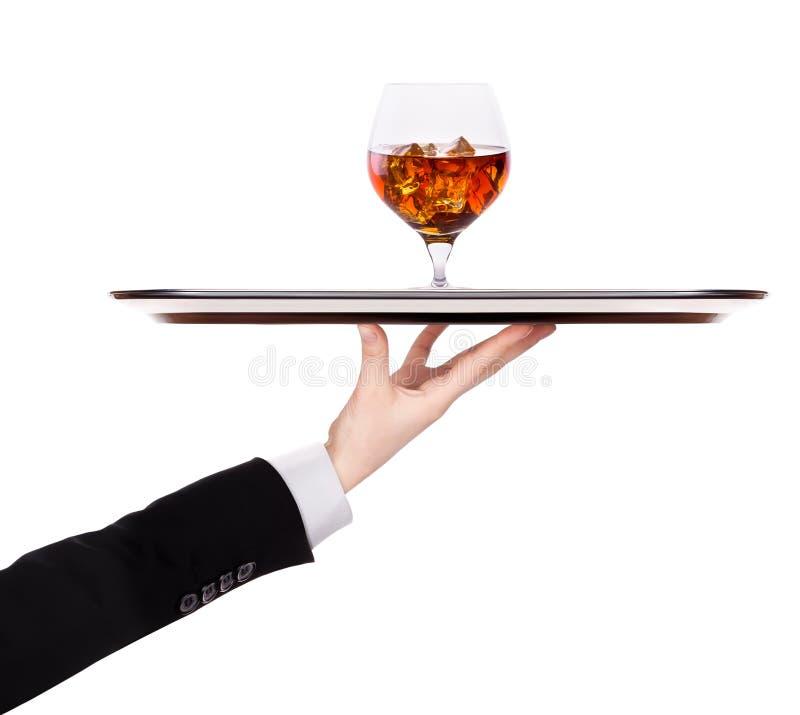Kelnera mienia srebra taca z brandy fotografia stock