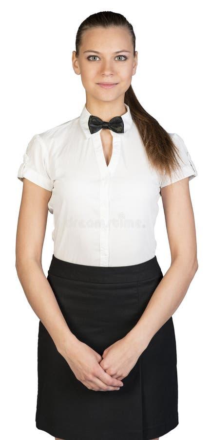 Kelnerka patrzeje kamerę z krzyżować rękami obrazy royalty free