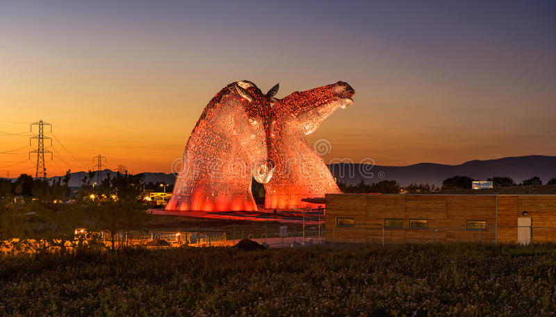 The Kelpies Horse statue, Falkirk, Scotland. FALKIRK, UNITED KINGDOM - SEPTEMBER 7, 2015 : The Kelpies Horse statue lit up at night at The Helix Park in Falkirk stock photo