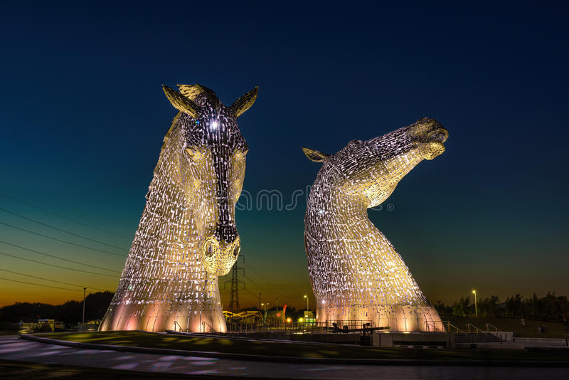 The Kelpies Horse statue, Falkirk, Scotland. FALKIRK, UNITED KINGDOM - SEPTEMBER 7, 2015 : The Kelpies Horse statue lit up at night at The Helix Park in Falkirk royalty free stock photo