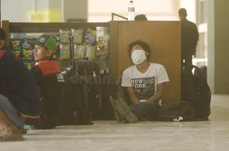 THE KELUD ERUPTION EFFECT. A passenger is sleeping after his flight got canceled due the closing of Adi Soemarmo Airport of Surakarta which was covered by ash stock images