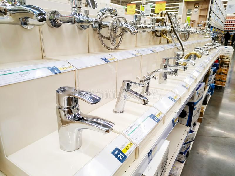 Various faucets are sold in a large building materials store Leroy Merlin stock image
