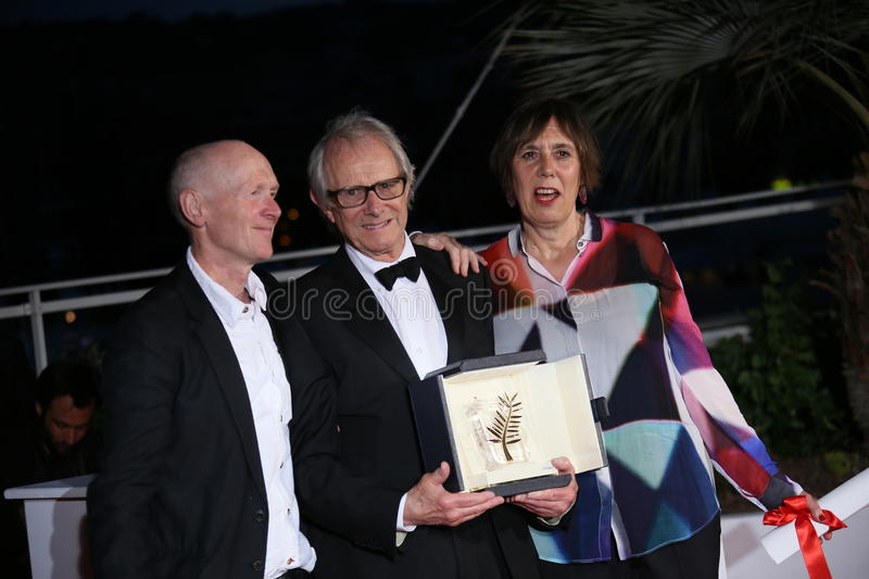 Ken Loach. Screenwriter Paul Laverty and producer Rebecca O'Brien poses the Palme D'Or Winner Photocall during the 69th annual Cannes Film Festival at the stock images