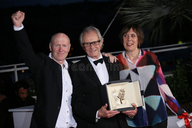 Ken Loach. Screenwriter Paul Laverty and producer Rebecca O'Brien poses the Palme D'Or Winner Photocall during the 69th annual Cannes Film Festival at the royalty free stock photos
