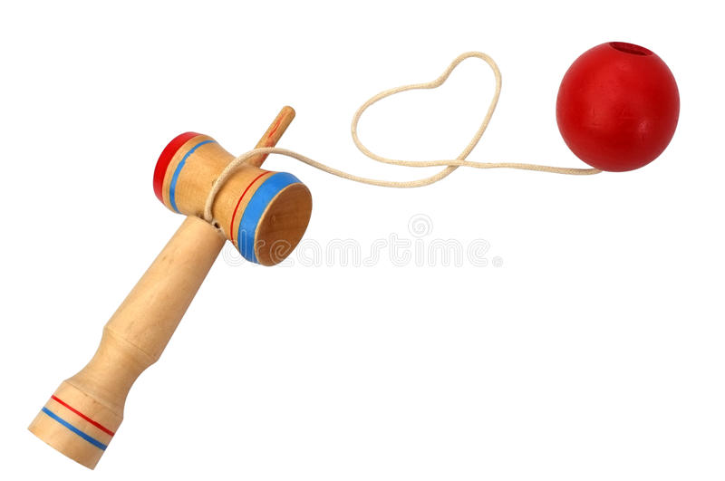 Kendama, a traditional Japanese toy consisting of a sword and a ball connected by a string rolled in heart shape stock photography