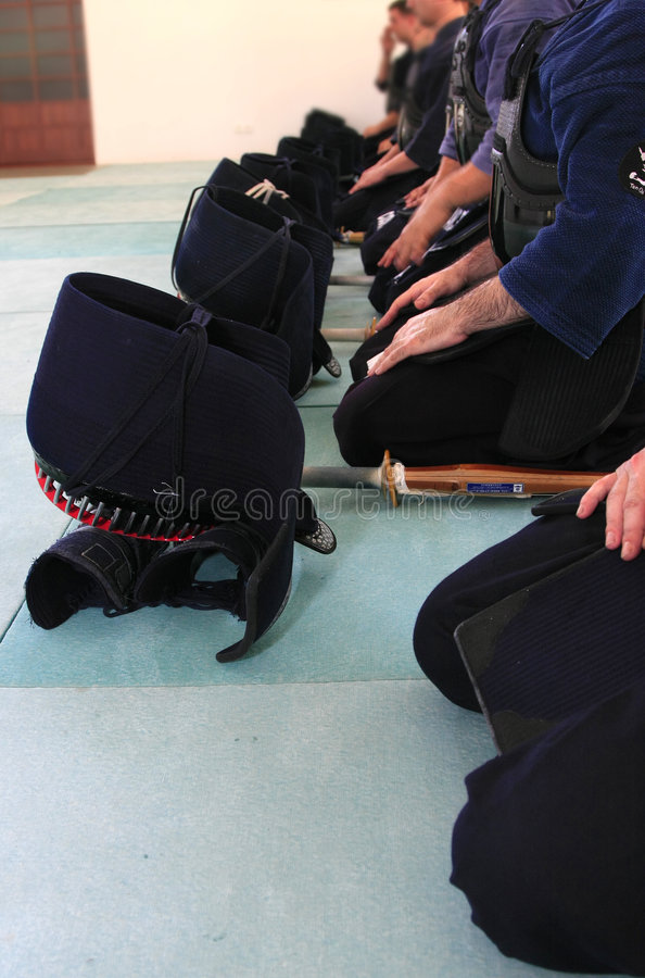 Kendo - Group of people preparing to fight. Group of people preparing to fight; Kendo equipment (japanese fencing royalty free stock images