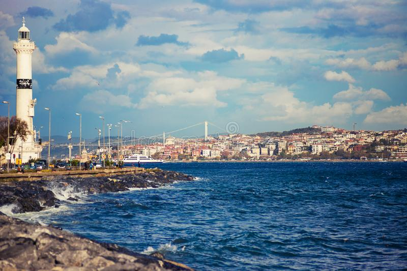 Kennedy avenu with lighthouse and Bosphorus Bridge in the distance, Istanbul, Turkey. Kennedy avenu with lighthouse and Bosphorus Bridge in the distance on a stock photography