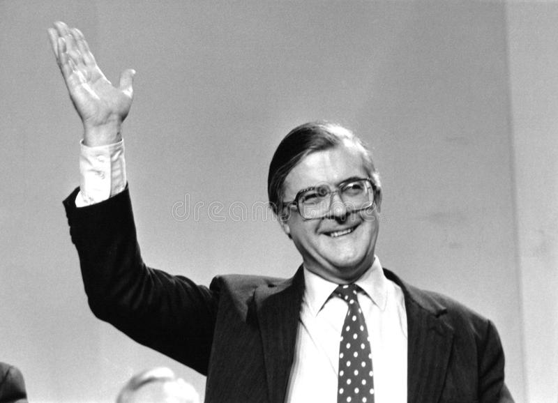 Kenneth Baker. Home Secretary and Conservative party Member of Parliament for Mole Valley, waves to the audience at a conference in London on March 3, 1990 stock image