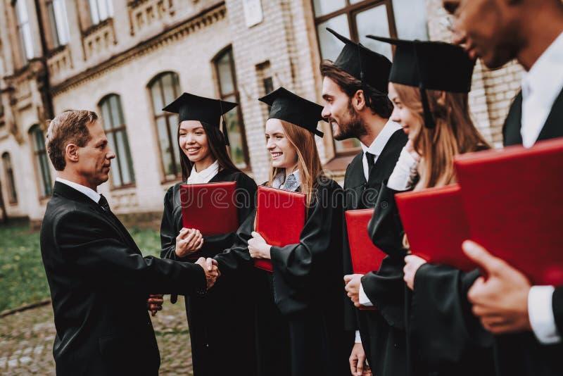 Kennis glb vrolijk leraar diploma's stock afbeeldingen