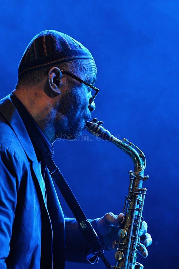 Kenny Garrett in plays alto saxophone during summer jazz festival OpenJazzFest Zelena Voda, Slovakia, 30th of July 2017. Kenny Garrett plays alto saxophone royalty free stock images