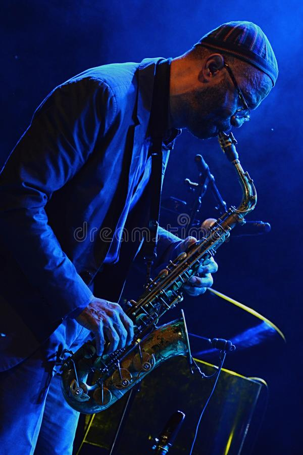 Kenny Garrett plays alto saxophone during summer jazz festival OpenJazzFest Zelena Voda, Slovakia, 30th of July 2017. There are some flies and midges behind stock photo