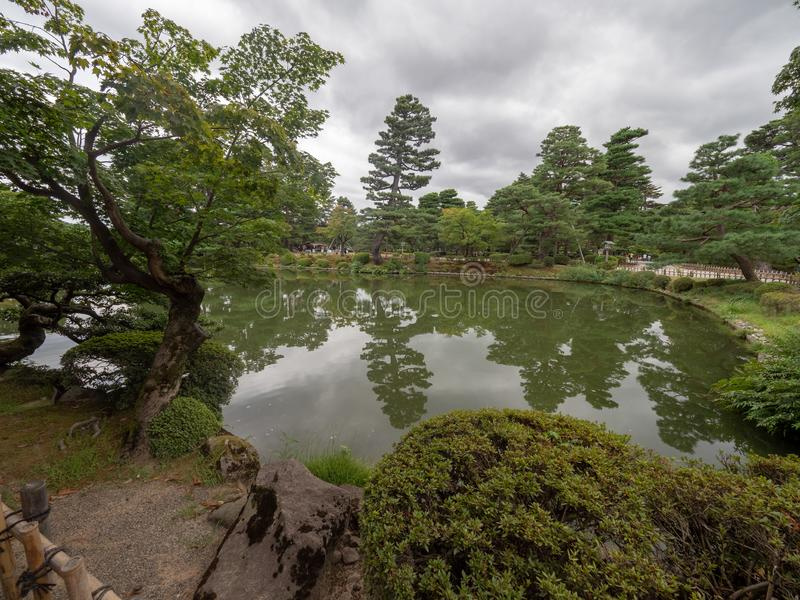 Kenroku-en gardens, Kanazawa, Japan. Kanazawa/Japan - August 10 2018: Kenroku-en, is an old private garden. It is one of the Three Great Gardens of Japan royalty free stock photo
