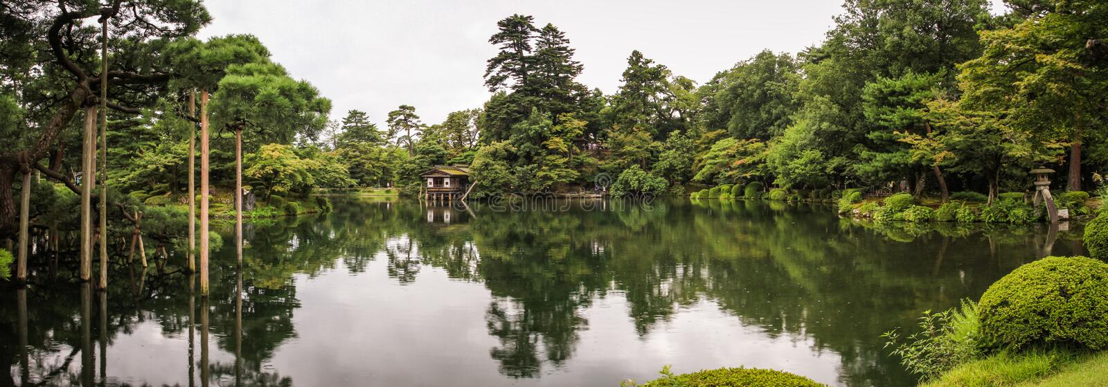 Panorama of the picturesque Kenroku-en gardens, Kanazawa, Ishikawa, Japan. Kenroku-en located in Kanazawa, Ishikawa, Japan, is an old private garden. Along with stock photos