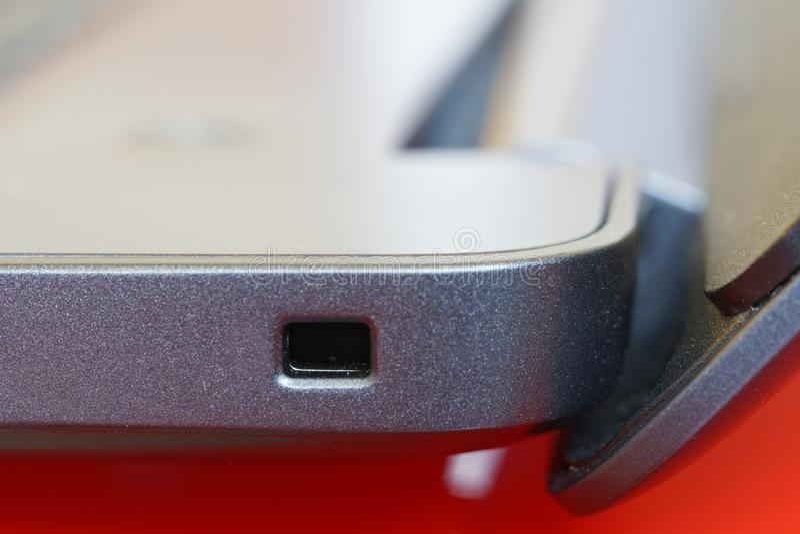 Kensington lock slot on a modern laptop. Modern technologies. Macro. Close-up royalty free stock photo