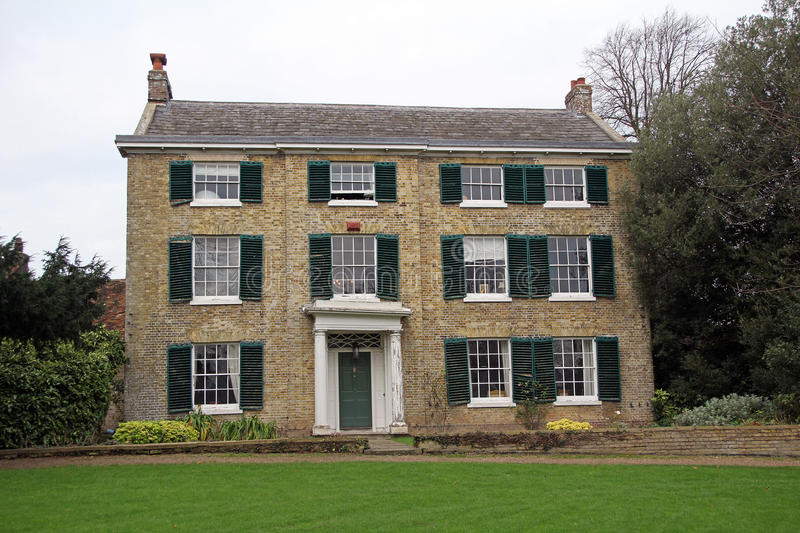 Kent georgian period manor house. Photo of kent georgian period manor house with green shutters in a quiet peaceful rural location. photo taken 2nd december 2015 royalty free stock images
