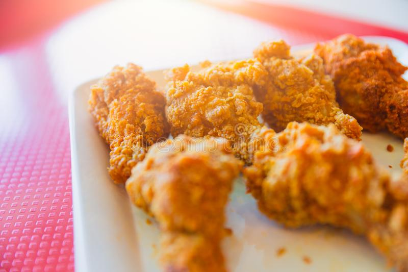 Kentucky style fried chicken on red background. With space for text stock photo