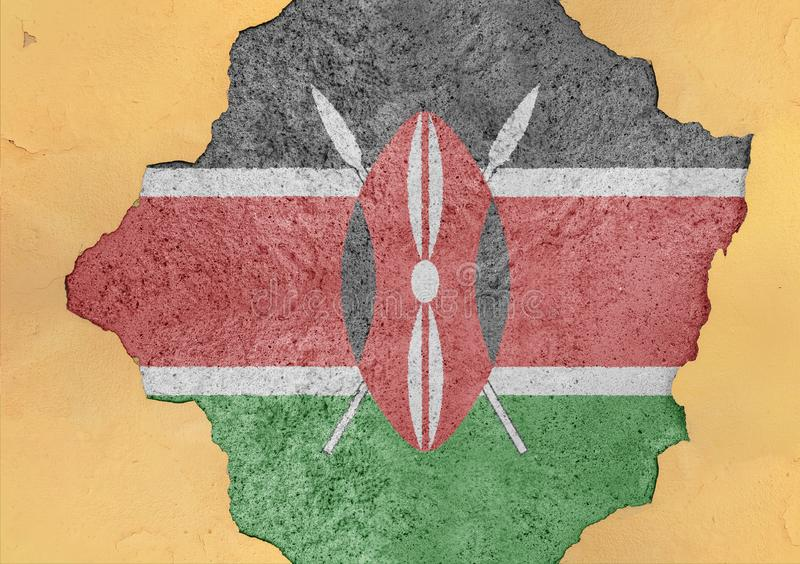 Kenya cracked hole and broken flag in big concrete material facade. Structure royalty free stock images