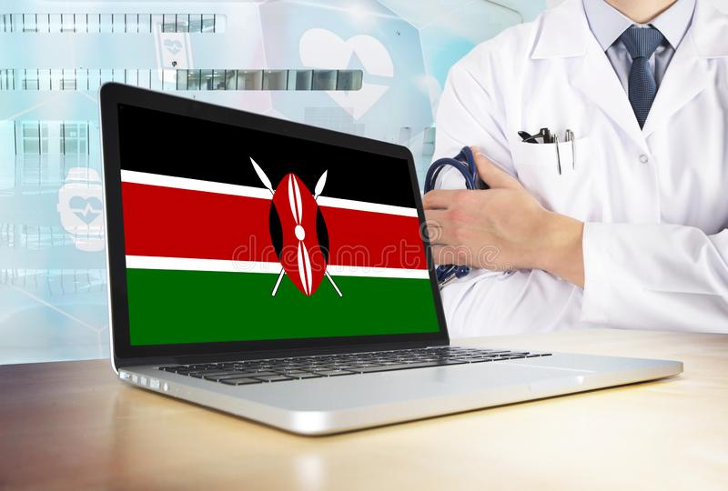 Kenya healthcare system in tech theme. Kenyan flag on computer screen. Doctor standing with stethoscope in hospital. Cryptocurrency and Blockchain concept stock images