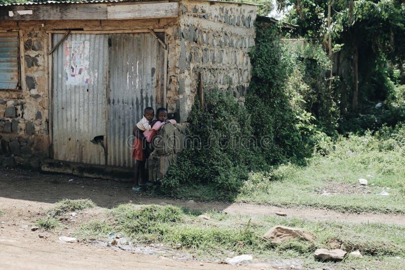 KENYA, KISUMU - MAY 20, 2017: Young african man preparing his boat before work, fishing. People and children taking royalty free stock photos