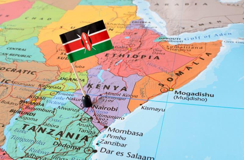 Kenya map and flag pin. Kenya paper flag pin on a map, exotic travel concept royalty free stock photo