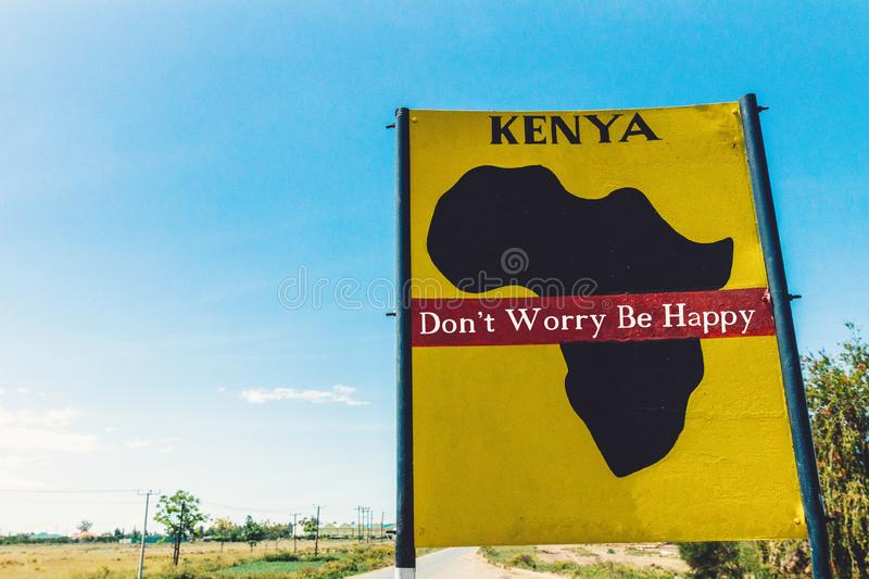 Kenya for the people signpost in yellow colors and blue sky by the side of the road in Africa. Freedom, people, quote, future, pre royalty free stock images