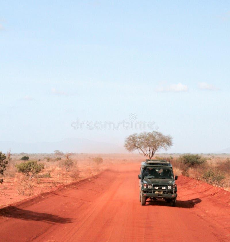 Kenya, Tsavo East - jeep safari on red road stock photo