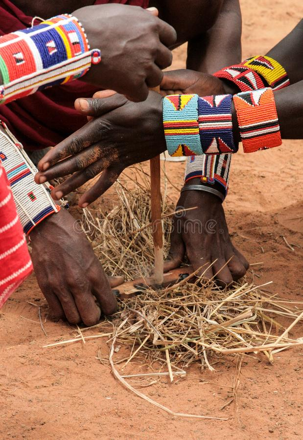 Kenya, Tsavo East - masai people setting the fire by their hands royalty free stock photos