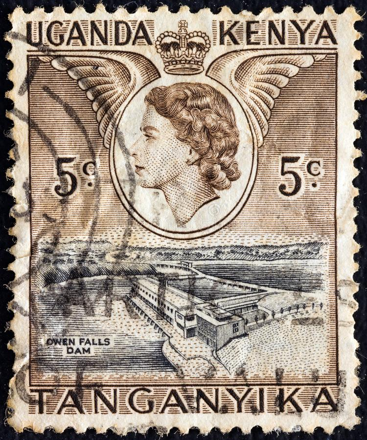KENYA UGANDA TANGANYIKA - CIRCA 1954: A stamp printed in Kenya Uganda Tanganyika shows Owen falls dam, circ royalty free stock photo