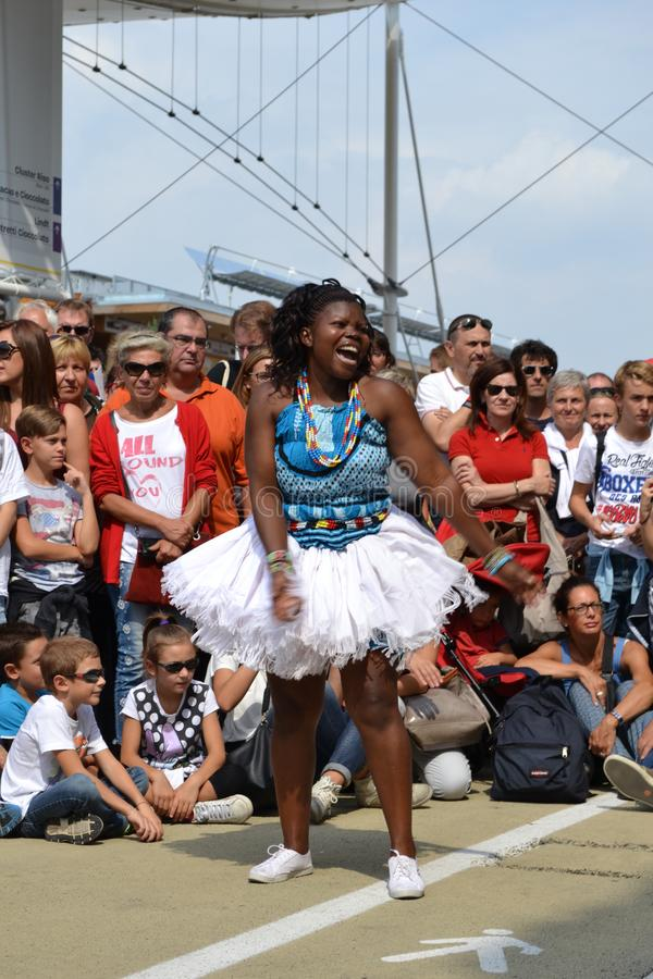 Kenyan female dancer is performing at the EXPO Milano 2015. stock images