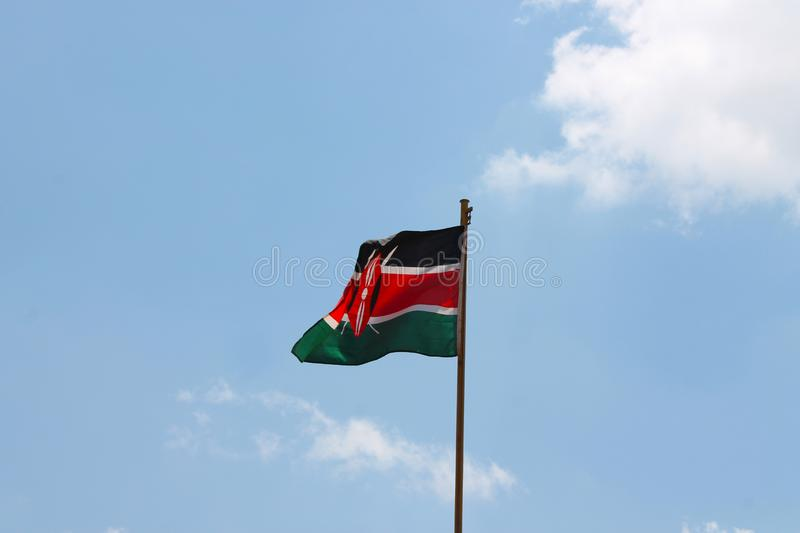 Kenyan flag blowing in the wind stock images