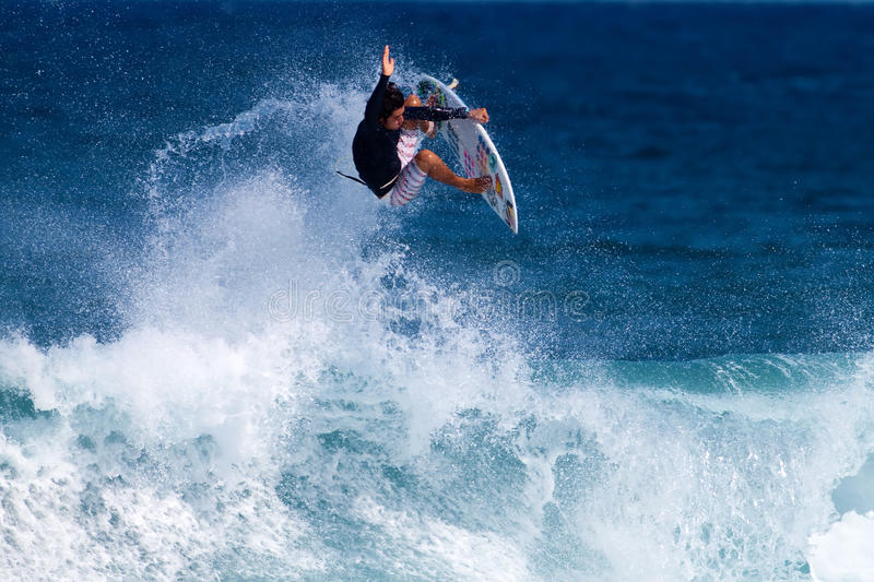 Keoni Jones Surfing at Rocky Point in Hawaii. Professional surfer, Keoni Jones, catches air on a wave while surfing at Rocky Point on the North Shore of Oahu, in royalty free stock image