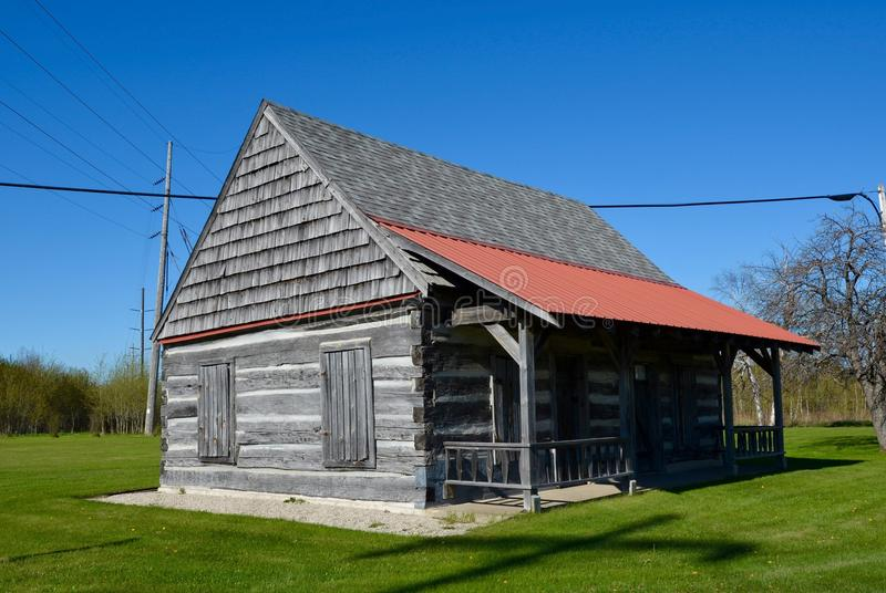 Kepler Log Cabin. This is a Spring picture of the Alva C. Kepler log cabin home in Manistique, Michigan. The log cabin of one of the oldest settlers of School royalty free stock photography