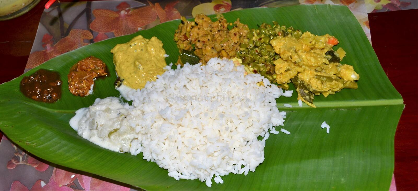 Kerala Banana Leaf Feast. With colourful curries, each having distinct sweet, salty, sour, pungent, bitter & astringent stock photo