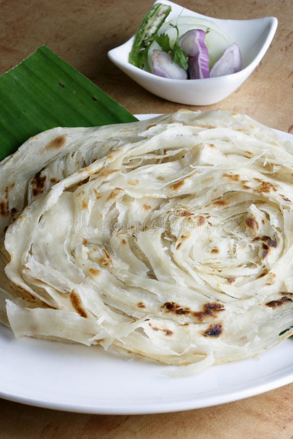 Kerala Paratha - a layered flatbread from Kerala. Kerala Paratha - a layered flatbread from South Indian state of Kerala served with coconut chutney and sambar royalty free stock photography