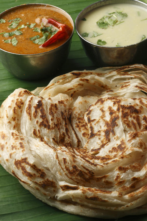 Kerala Paratha - a layered flatbread from Kerala. Kerala Paratha - a layered flatbread from South Indian state of Kerala served with coconut chutney and sambar royalty free stock image