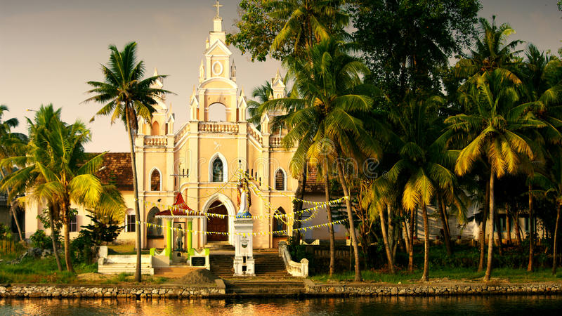 Kerala. Portugese church in the tropical landscape of the backwaters of Kerala, India royalty free stock photo