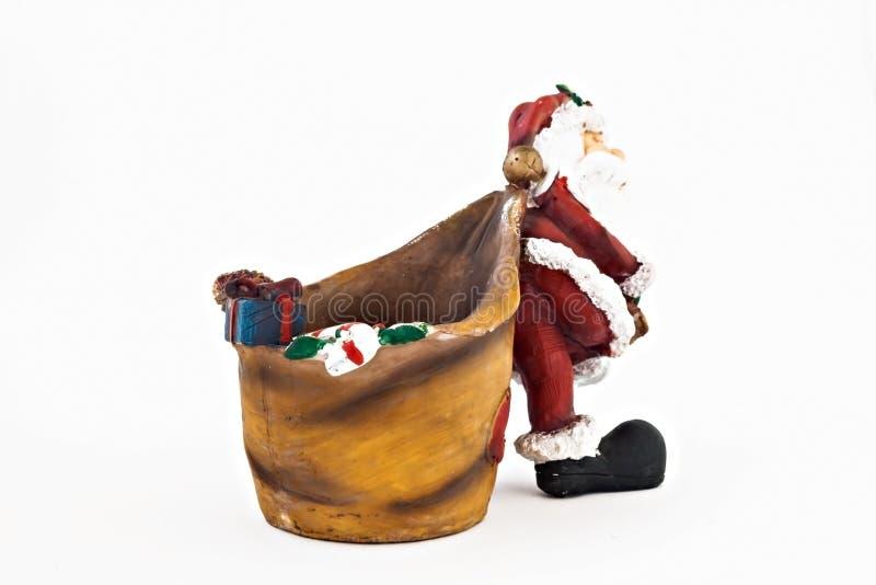 Keramische Figürchen von Santa Claus mit einem großen Sack lizenzfreies stockbild