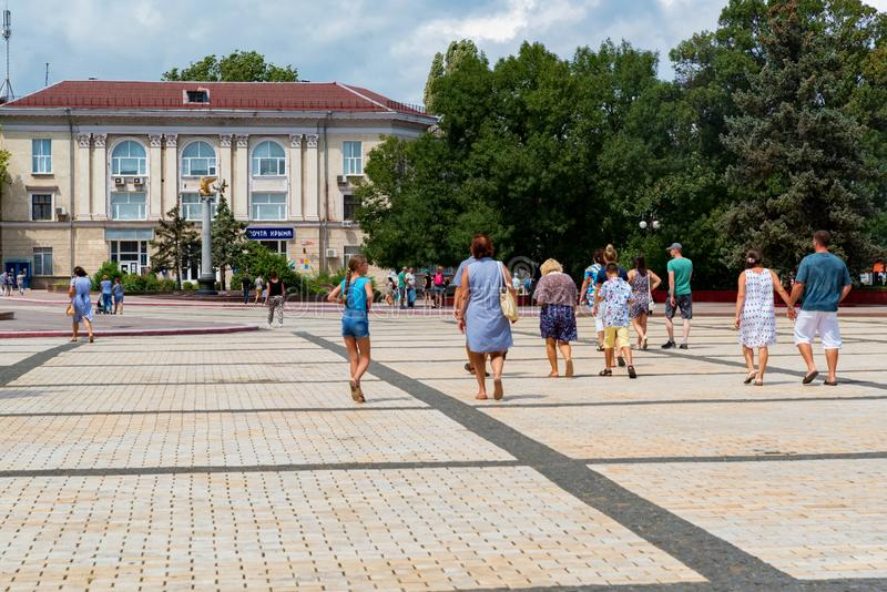 KERCH, RUSSIA - 5 AUGUST 2019: people walk next on Lenina square in Kerch royalty free stock photo