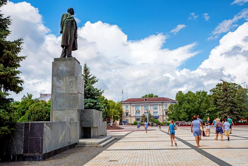KERCH, RUSSIA - 5 AUGUST 2019: people walk next to monument to Lenin royalty free stock image