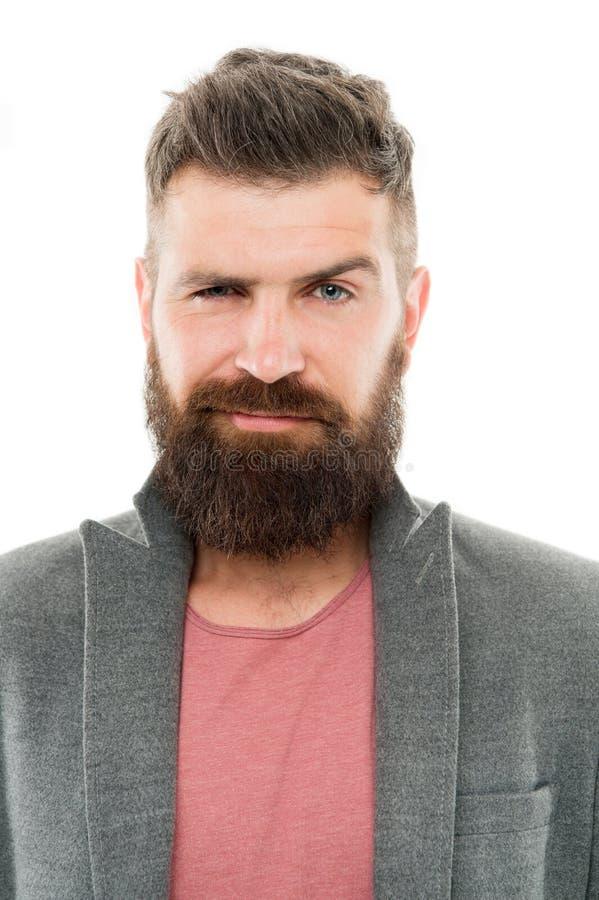 Kerelmode is vrij formules Trendy hipster met een snor en een lange baard met een modejas en een spijkerbroek royalty-vrije stock foto's