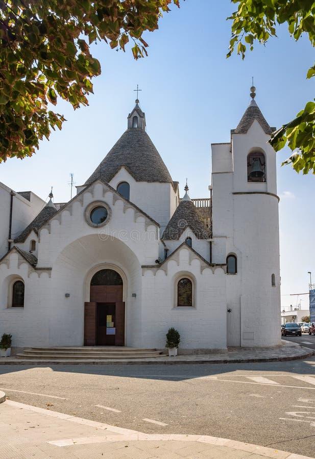 Download Kerk In De Parochie Van Sant Antonio In Alberobello Stock Afbeelding - Afbeelding bestaande uit zeegebied, parochie: 107703035