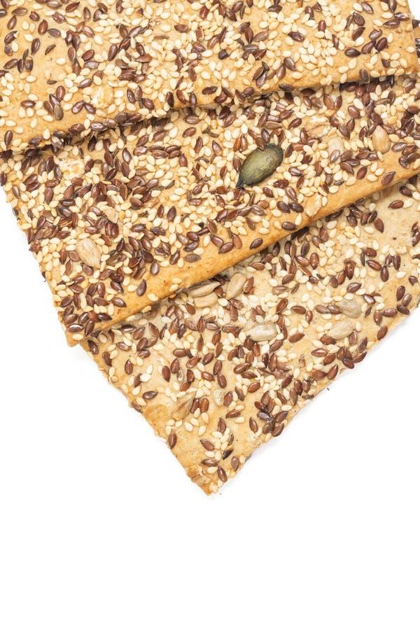Kernachtig brood met sesamchia en andere die graangewassen boven witte achtergrond worden geïsoleerd royalty-vrije stock foto