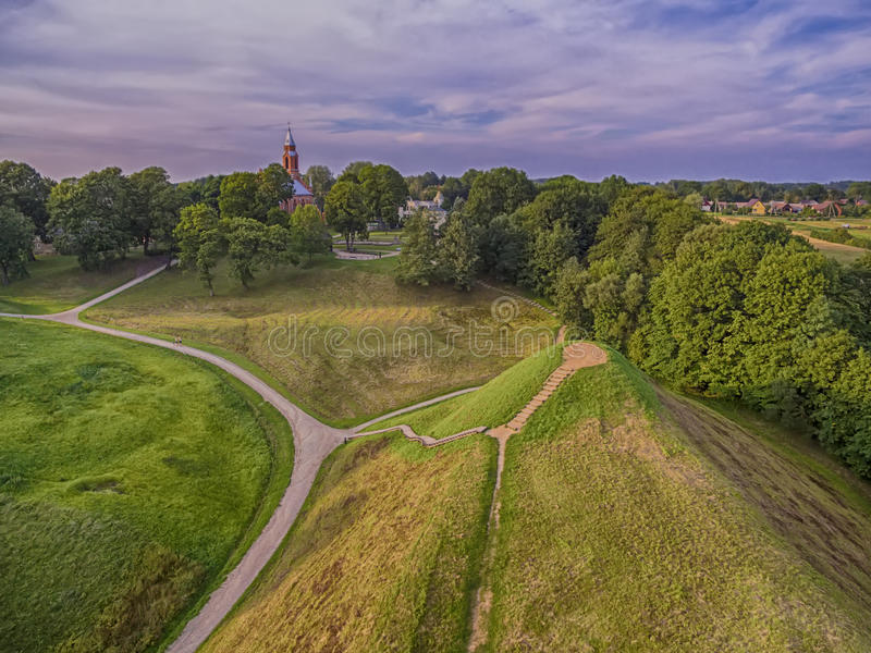 Kernave, historical capital city of Lithuania, aerial top view. Aerial top view of Kernave, historical capital city of Lithuania, in the sunset royalty free stock image