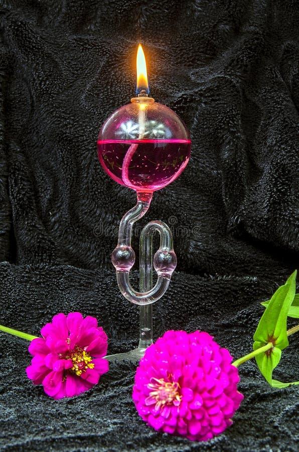 Kerosene lamp with fragrance. On the black velvet stock images
