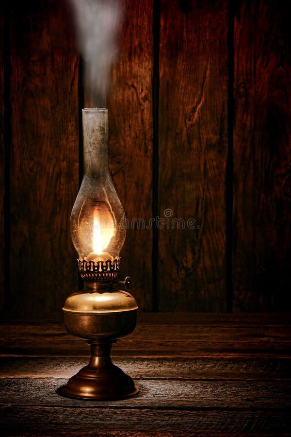 Kerosene Oil Lantern Lamp Smoke In Old Ranch Barn Stock