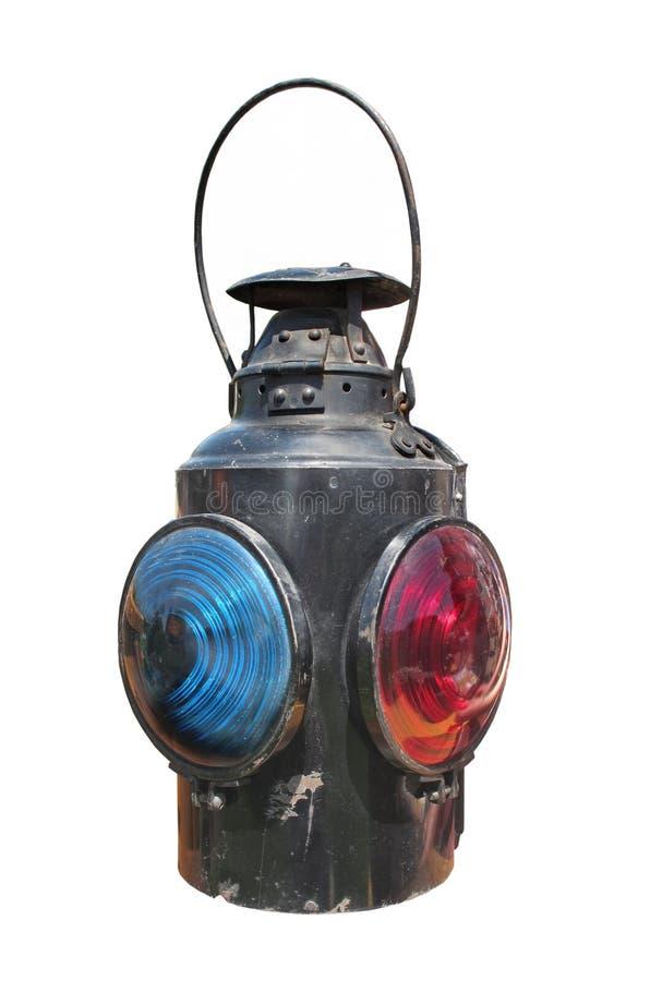 Kerosene railroad signal lantern isolated. Old kerosene railroad signal lantern with both blue and red lenses. Isolated on white royalty free stock image