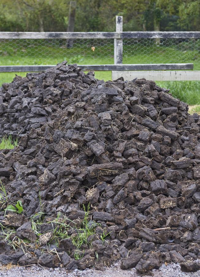 Kerry Bog Village - mound of peat. Ireland Trip May 19-29, 2019 Kerry Bog Village on the Ring of Kerry. Pile of peat for fuel royalty free stock photos